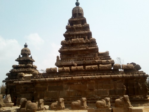 The Shore Temple (built in 700–728 AD) is so named because it overlooks the shore of the Bay of Bengal. It is located near Chennai in Tamil Nadu. It is a structural temple, built with blocks of granite, dating from the 8th century AD. At the time of its creation, the site was a busy port during the reign of Narasimhavarman II of the Pallava dynasty. As one of the Group of Monuments at Mahabalipuram, it has been classified as a UNESCO World Heritage Site since 1984. It is one of the oldest structural (versus rock-cut) stone temples of South India.