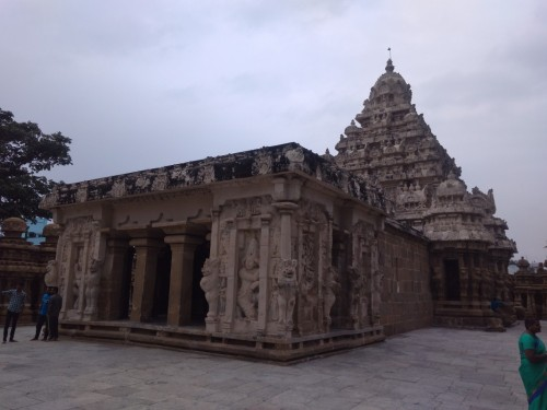 The Kanchi Kailasanathar temple is the oldest structure in Kanchipuram. Located in Tamil Nadu, India, it is a Hindu temple in the Tamil architectural style. It is dedicated to the Lord Shiva, and is known for its historical importance. The temple was built from 685-705CE by a Rajasimha (Narasimhavarman II) ruler of the Pallava Dynasty. The low-slung sandstone compound contains a large number of carvings, including many half-animal deities which were popular during the early Pallava architectural period. The structure contains 58 small shrines which are dedicated to various forms of Shiva. These are built into niches on the inner face of the high compound wall of the circumambulatory passage.